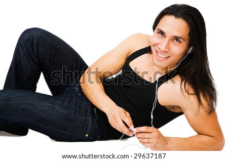 Man listening to MP3 player and smiling isolated over white