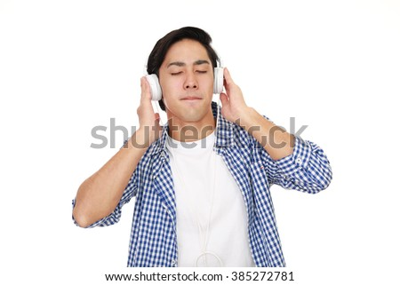 Man listening to music - stock photo