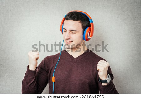 man listening to music on headphones and dancing - stock photo