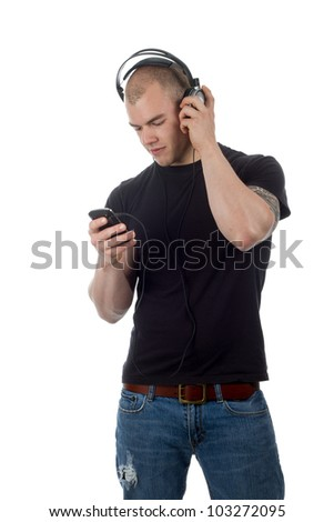 Man listening to music with headphones - stock photo