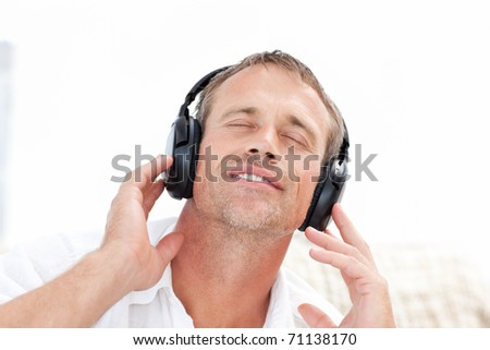 Man listening to some music at home - stock photo