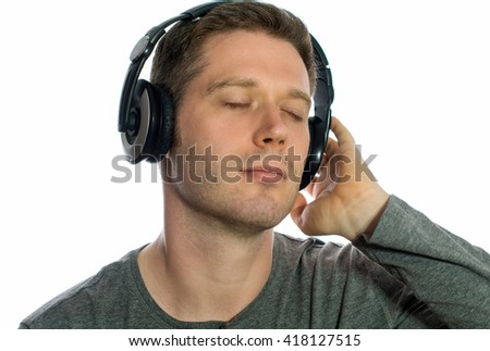 Man listening to the music in headphones. Isolated on white.