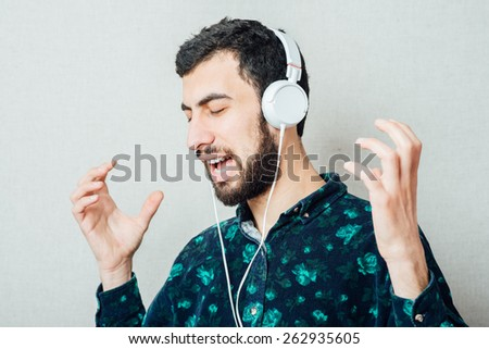 man listens music with headphones - stock photo