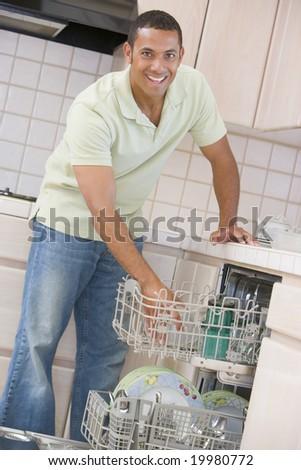 Man Loading Dishwasher - stock photo