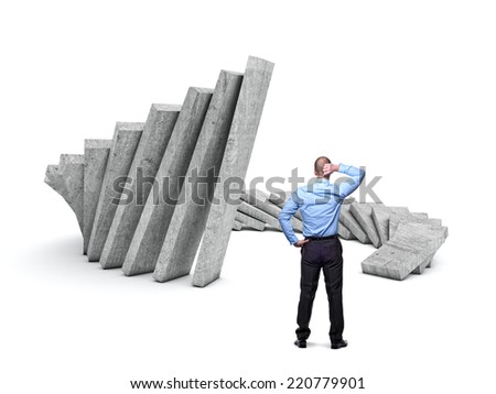man look huge concrete walls falling - stock photo