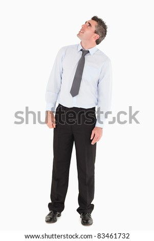 Man looking at a copy space against a white background - stock photo