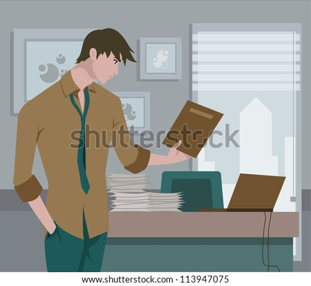 Man looking at a file in an office