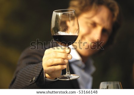 Man looking at a glass of wine - stock photo
