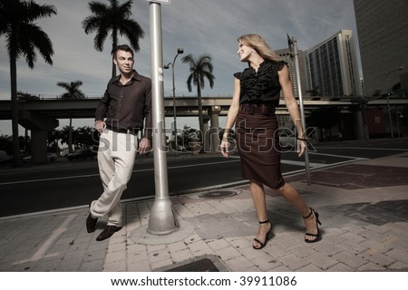 Man looking at a woman passing by - stock photo