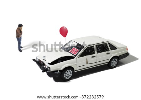 Man Looking at Automobile For Sale (Model) - stock photo