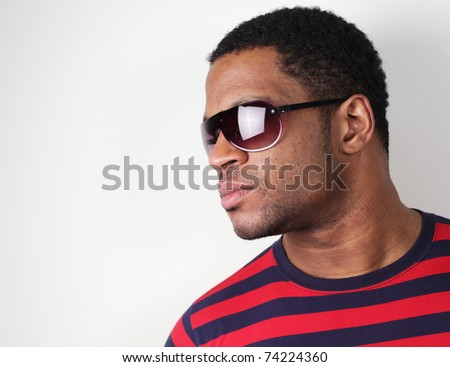 Man looking at bright light with Sunglasses - stock photo