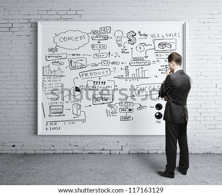 man looking at business strategy on board - stock photo