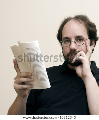 Man looking at camera with a book on his hand