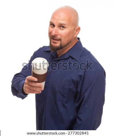 Man looking at camera with coffee cup and smile on his face. - stock photo