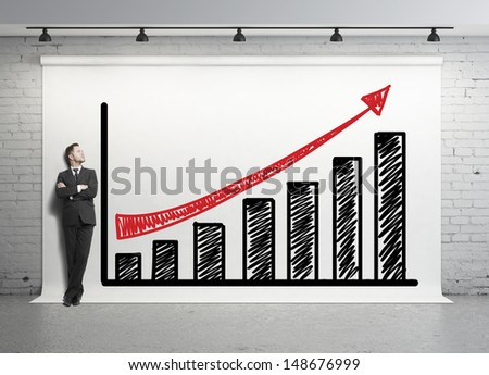 man looking at chart on white backdrop - stock photo