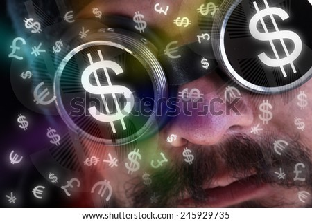 Man looking at flying currency icons wearing dark goggles - financial concept - stock photo