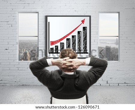 man looking at growth chart on poster - stock photo