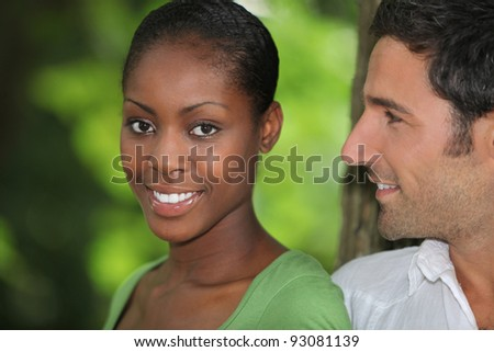 Man looking at his beautiful girlfriend - stock photo