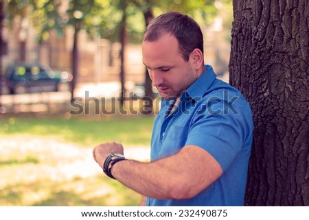 Man looking at his watch  - stock photo