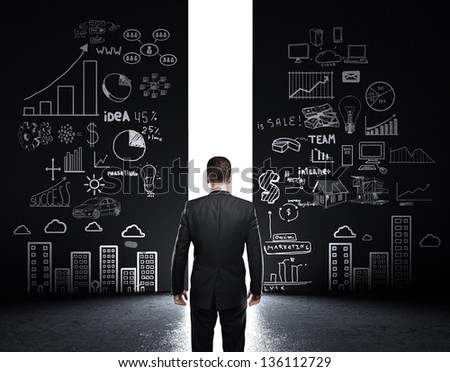 man looking at opened concrete wall with drawing strategy - stock photo