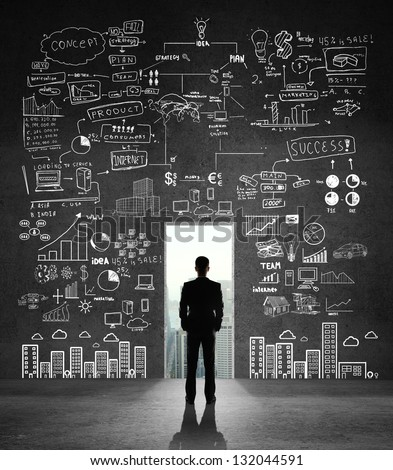 man looking at opened door and drawing business concept - stock photo