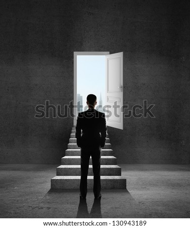 man looking at opened door and leader - stock photo