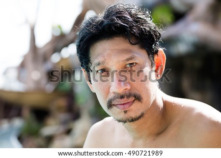 Man looking at the camera  lifestyle in swimming pool,Portrait man face
