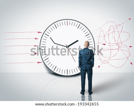 man looking at the delay clock and time management on the wall - stock photo