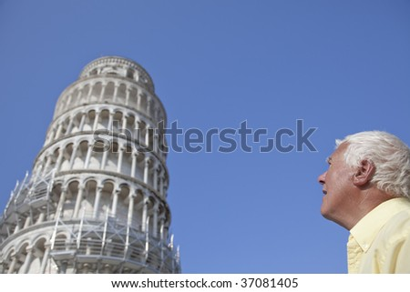 Man looking at the leaning tower in Pisa, Italy. - stock photo