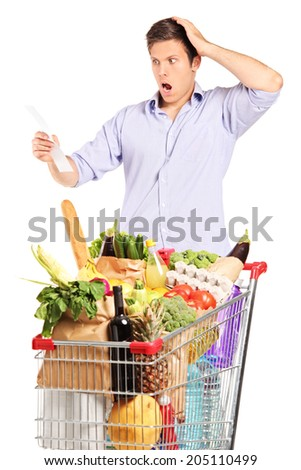Man looking at the shopping bill in disbelief isolated on white background
