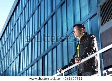 Man looking away. Fashion urban scene.  - stock photo
