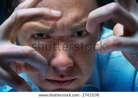 man looking by fingers