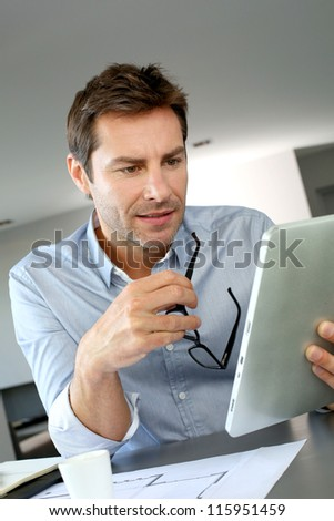 Man looking construction details for his new house - stock photo