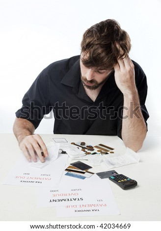 Man looking depressed about his financial situation - stock photo