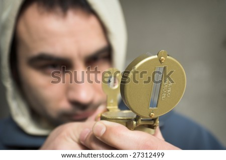 Man looking for reference point - stock photo