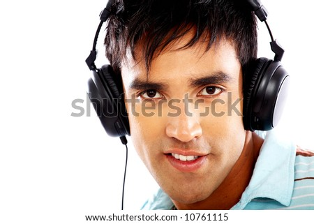 man looking happy listening to music on his headphones isolated over a white background - stock photo