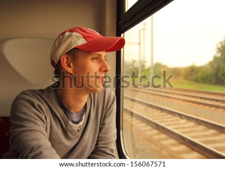 man looking out of the train window - stock photo