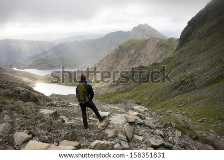 man looking out to mountain view, snowdon - stock photo