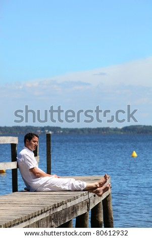 Man looking out to sea. - stock photo
