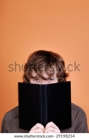 Man looking over the book
