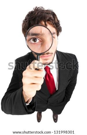 Man looking through a lens - stock photo