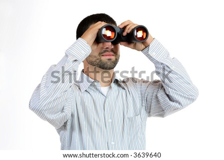 Man looking through binoculars - stock photo