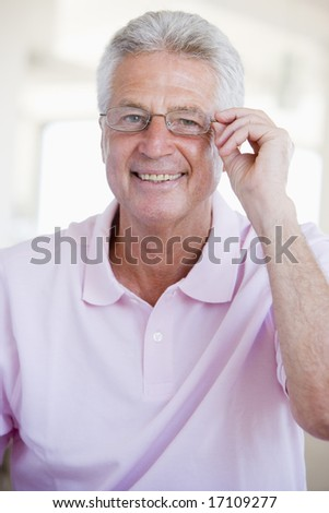 Man Looking Through New Glasses - stock photo