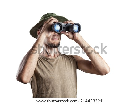 Man looking through the binocular isolated on white background - stock photo