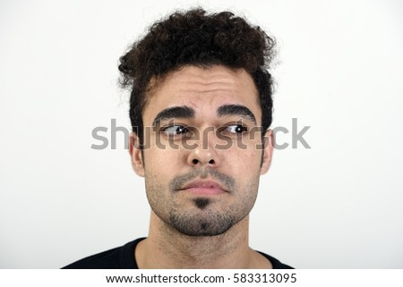 Man looking to his left with a sad expression