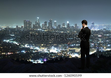 man looking to night city - stock photo