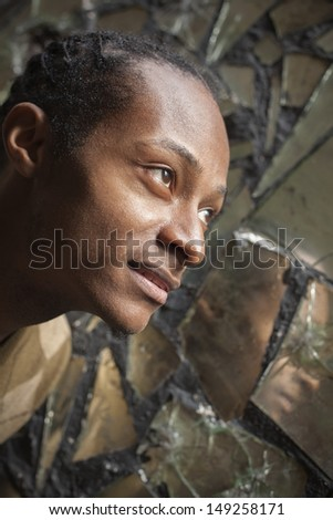 Man looking to sky for answers - stock photo