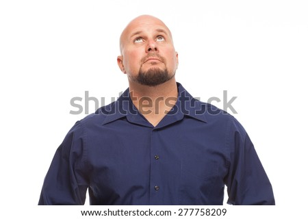 Man looking up and concerned.  Portrait of bald, handsome young man isolated on white background.  - stock photo