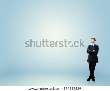 man looking up at empty space - stock photo