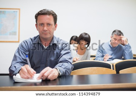 Man looking up from class in college - stock photo